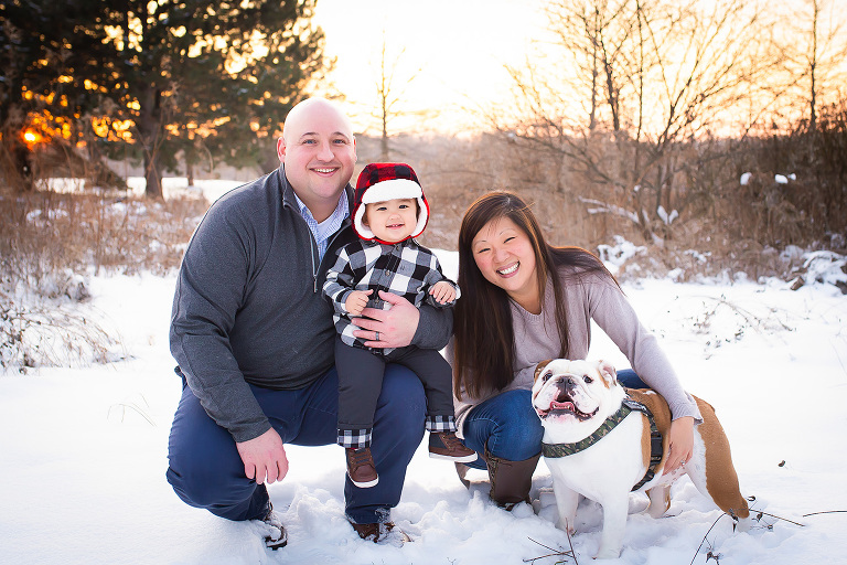 family photographer in rochester ny captures family playing together in the snow