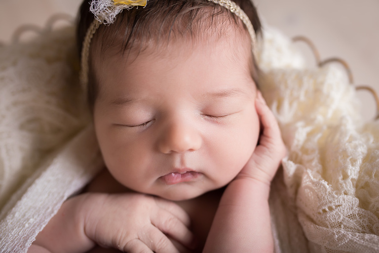 newborn photographer in rochester, ny captures newborn baby sleeping with chin on hand