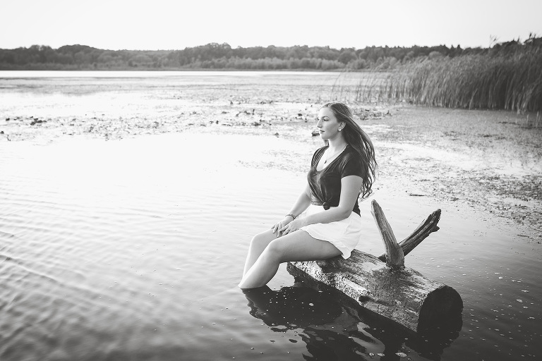 family photographer in rochester ny captures highschool senior looking out at her future