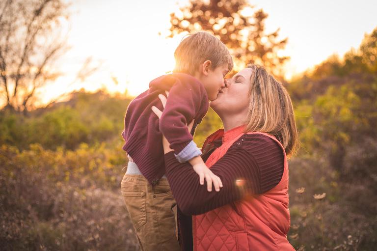rochester family photographer captures mom loving on son
