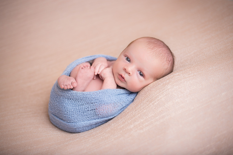 photographer in rochester ny captures alert baby looking right at the camera
