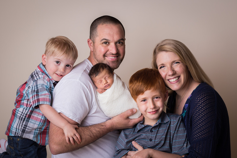 family photographer in rochester, ny captures family with new baby