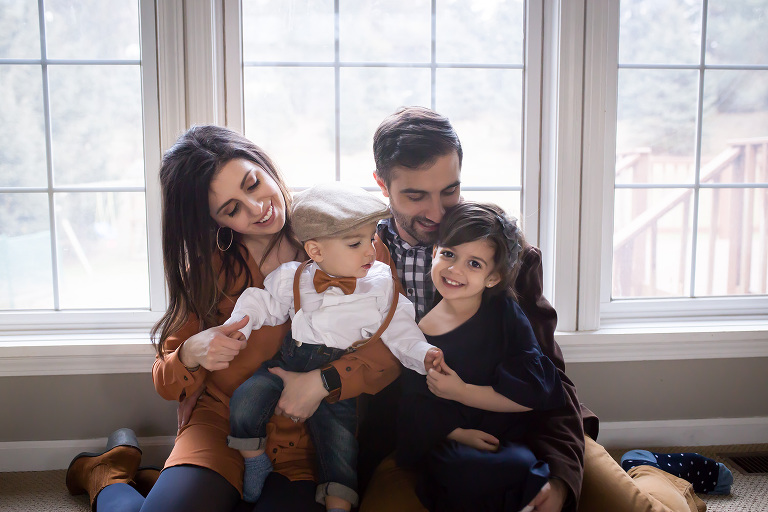 family photographer in rochester, ny captures family playing together in their home