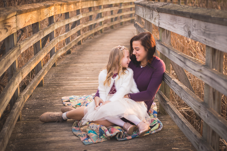 rochester family photographer captures sisters laughing at sunset