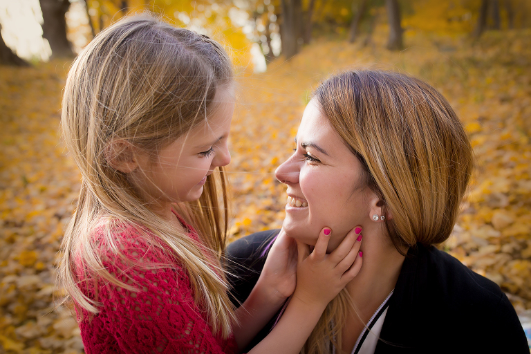 family photographer in rochester ny captures mom and daughter looking at each other lovingly