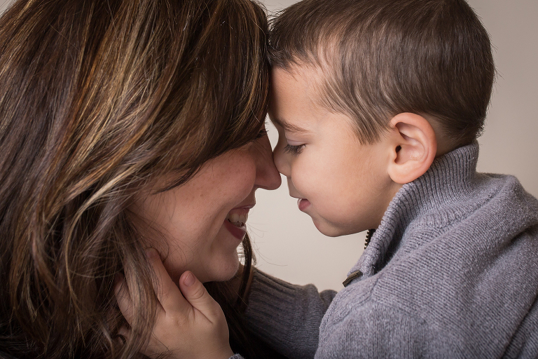 maternity photographer in rochester ny captures mom and son with their heads together