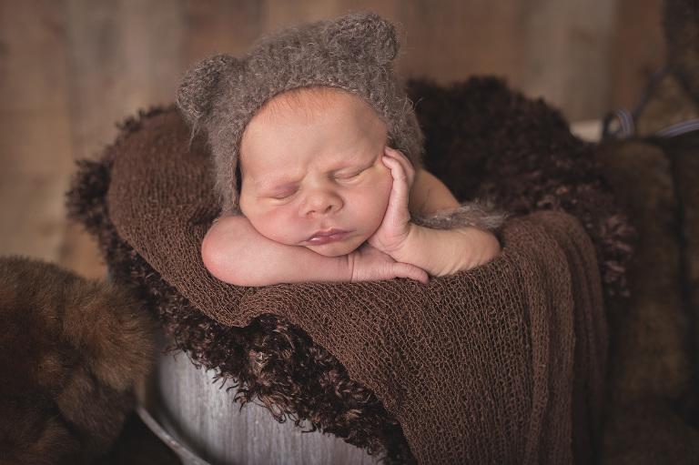 rochester photographer captures newborn baby in teddy bear bonnet