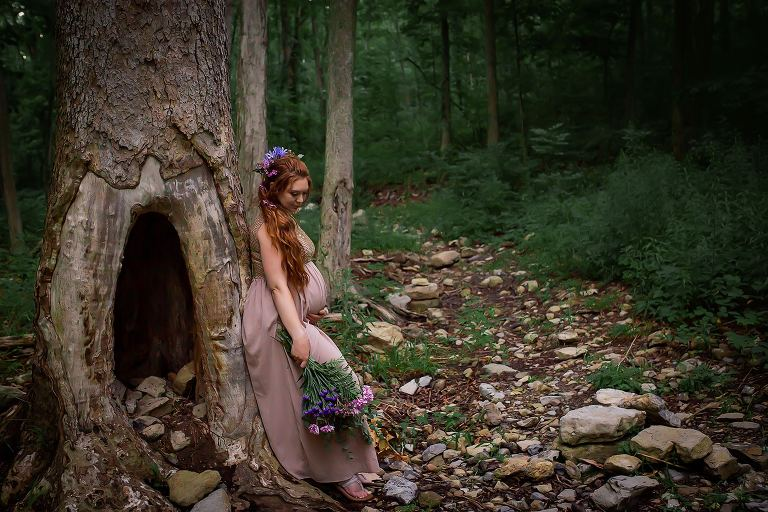 maternity photographer captures expectant mom in the woods