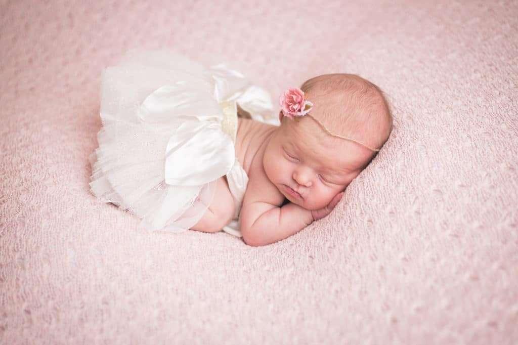 rochester ny newborn photographer captures newborn baby in white tutu