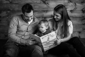 rochester ny family photographer captures parents reading son a book