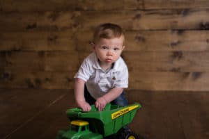 rochester family photographer captures little boy playing with truck