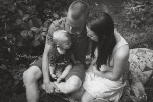rochester ny family photographer captures mom, dad and baby in the woods