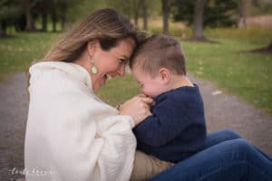 family photographer in rochester ny captures mom and son giggling together