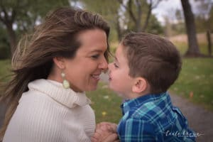 family photographer in rochester ny captures mom and son giving eskimo kisses in the park