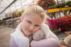 Family photographer in rochester ny captures family together in Lucas Greenhouse