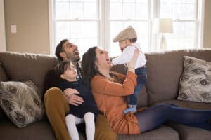 maternity photographer in rochester, ny captures mom and dad playing with their kids