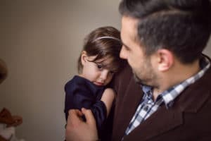 family photographer in rochester, ny captures dad cuddling daughter