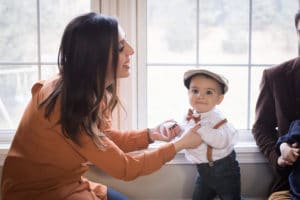 family photographer in rochester, ny captures mom dancing with son