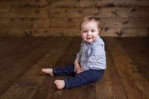 family photographer in rochester, ny captures baby boy smiling