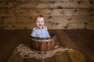 maternity photographer in rochester, ny captures baby boy smiling