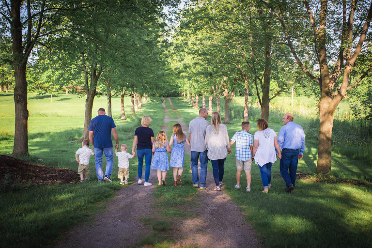 family photographer in rochester, ny captures extended family playing and smiling together