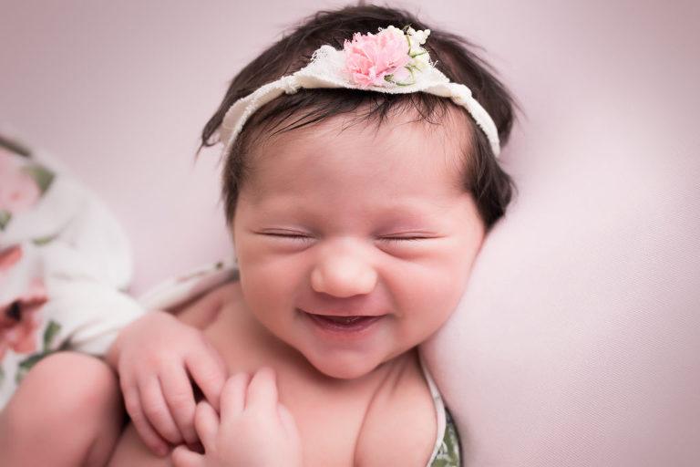 newborn photographer in rochester ny captures newborn baby girl sleeping