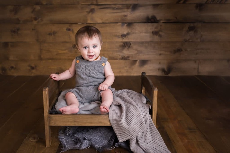 newborn photographer in rochester ny captures 8 month old baby boy for milestone photography session in baby's first year