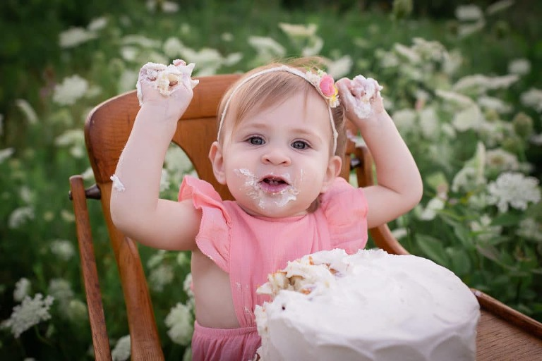 baby photographer in rochester ny captures baby girls first birthday portraits with cake smash and bubble bath in Tinker Park